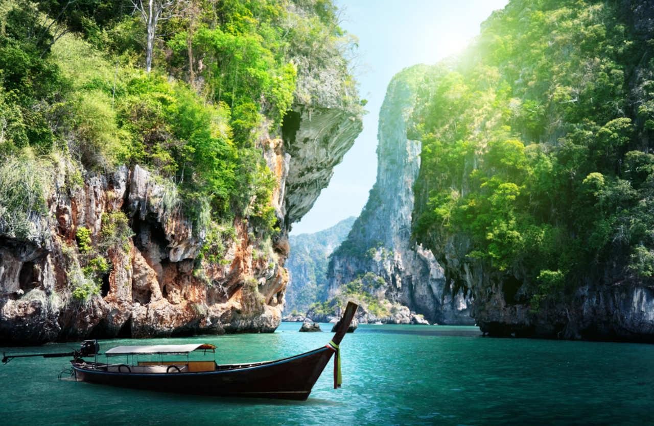 Boat in front of rocks