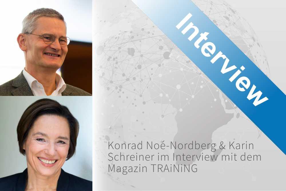 Konrad Noé-Nordberg und Karin Schreiner mit Globus im Hintergrund